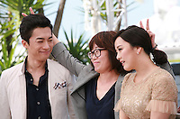 Actor Kim Young-Min, Director Shin Su-Won, singer Kwon So-Hyun at the Madonna film photo call at the 68th Cannes Film Festival Tuesday May 20th 2015, Cannes, France.