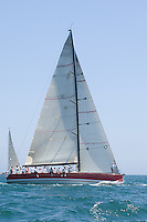 Triangular sail on yacht in competitive team sailing event California