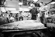 Tuna wholesaler Katsuhiki Kashima and sushi chef Masatoshi Yoshino at the Tsukiji Market, Tokyo, Japan