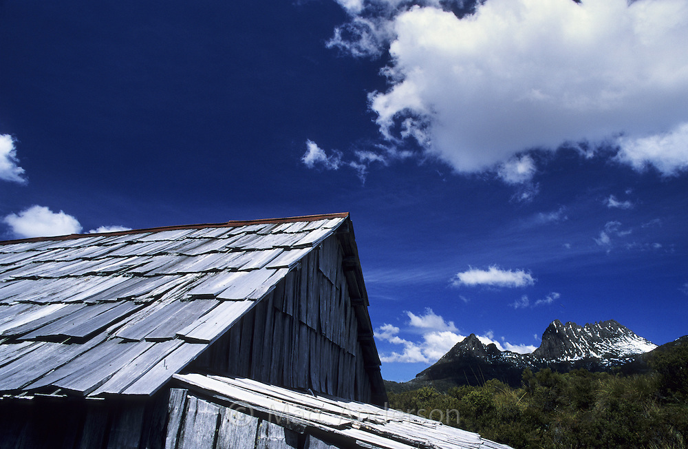 Roof of a boat shed and Cradle Mountain in the background, Tasmania