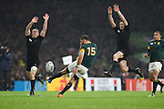 New Zealand players try and charge down a kick from South Africa full back Willie le Roux during the Rugby World Cup Semi-Final match between South Africa and New Zealand at Twickenham, Richmond, United Kingdom on 24 October 2015. Photo by David Charbit.