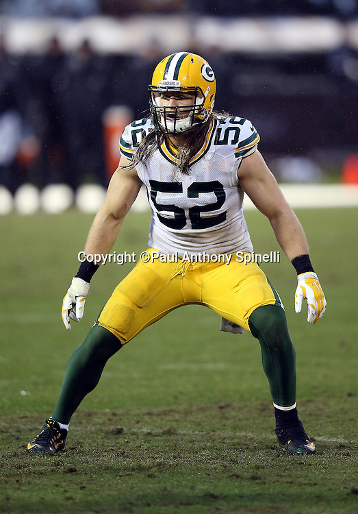 Green Bay Packers inside linebacker Clay Matthews (52) chases the action during the 2015 week 15 regular season NFL football game against the Oakland Raiders on Sunday, Dec. 20, 2015 in Oakland, Calif. The Packers won the game 30-20. (©Paul Anthony Spinelli)