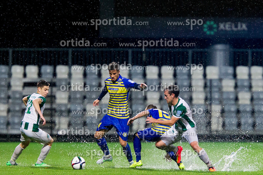 Gregor Sikosek #12 of NK Krsko and Davor Skerjanc #15 of FC Luka Koper during football match between FC Luka Koper and NK Krsko in 11th Round of Prva liga Telekom Slovenije 2015/16, on September 23, 2015 in Bonifika, Koper, Slovenia. Photo by Urban Urbanc / Sportida
