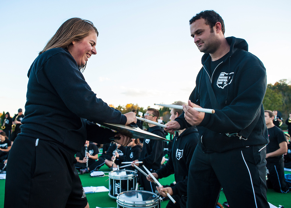 Lindsay Dickerson holding cymbal for Alex Marling