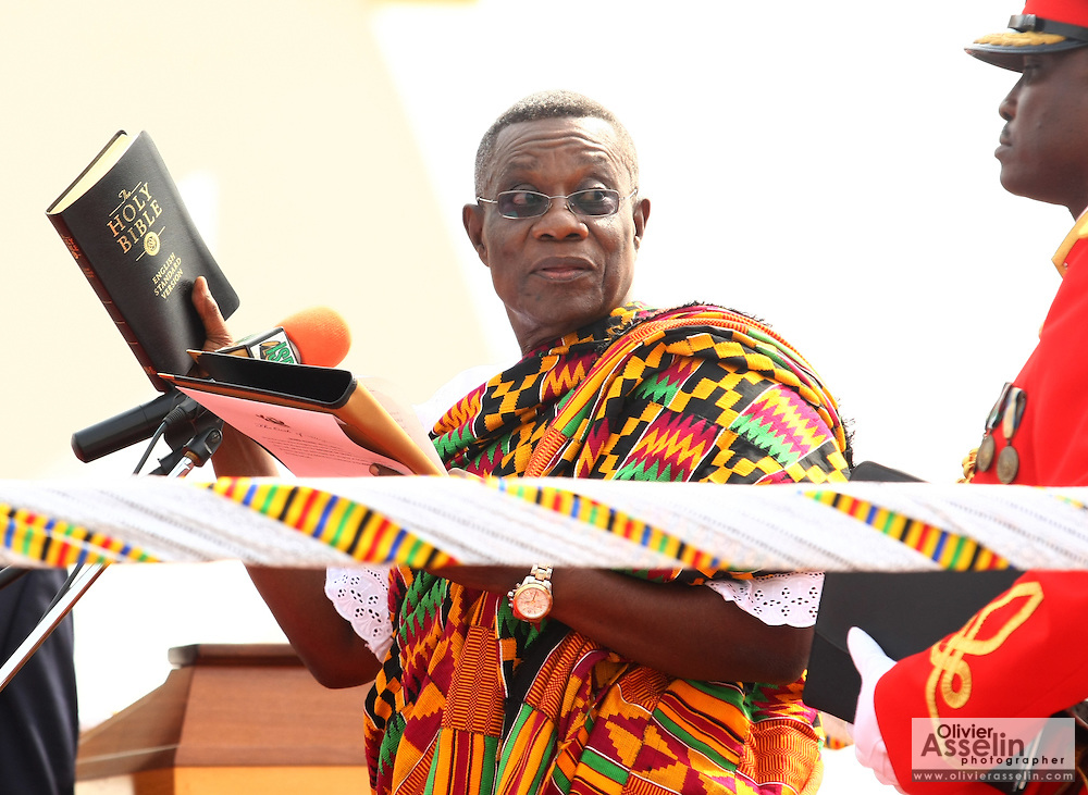 Ghana's new president John Atta Mills holds a bible during his inauguration in Accra, Ghana on Wednesday January 7, 2009.
