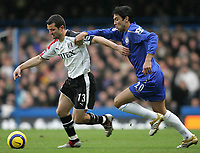 Photo: Lee Earle.<br /> Chelsea v Fulham. The Barclays Premiership. 26/12/2005. Fulham's Tomasz Radzinski (L) battles with Paulo Ferreira for the ball.