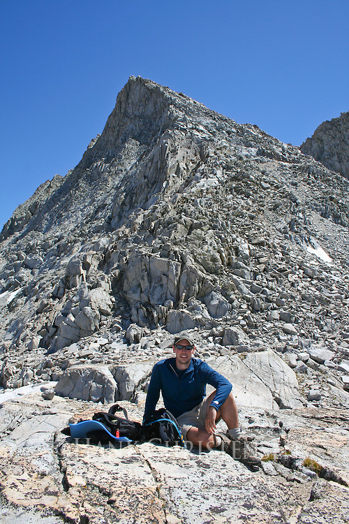 Hiker rests at the top of the pass between Sixty Lakes Basin and Gardiner Basin, King's Canyon National Park