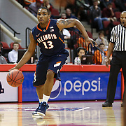 Tracy Abrams #13 of the Illinois Fighting Illini looks for an open lane during the NIT First Round game at Agganis Arena on March 19, 2014 in Boston, Massachusetts . (Photo by Elan Kawesch)