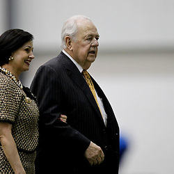 July 27, 2012; Metairie, LA, USA; New Orleans Saints owner Tom Benson and his wife Gayle Benson walk across the field during training camp at the team's indoor practice facility. Mandatory Credit: Derick E. Hingle-US PRESSWIRE