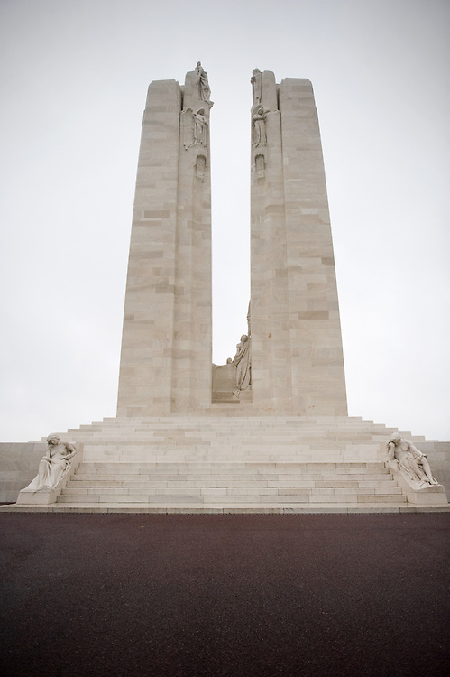 The back side (view from the Canadian Road) of the Canadian National Vimy Memorial dedicated to the memory of Canadian Expeditionary Force members killed in World War one. The monument is situated at a 100 hectare preserved battlefield with wartime tunnels, trenches, craters and unexploded munitions. The memorial designed by Walter Seymour Allward opened in 1936.