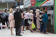 Royal Ascot racegoers at Waterloo station. London. 20 June 2013.
