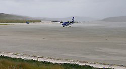 Barra Airport is a short-runway airport situated in the wide shallow bay of Traigh Mhòr at the north tip of the island of Barra in the Outer Hebrides, Scotland. Barra is now the only beach airport anywhere in the world to be used for scheduled airline services. Loganair Twin Otter approaching terminal building. (c) Stephen Lawson | Edinburgh Elite media