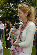 Eliza Macdonald-Buchanan holding Bee. Pug Dog club Tea party held at Cottesbrook Hall.  ( home of  Mr. and Mrs. Alastair Macdonald-Buchanan ) 26 June 2005. . ONE TIME USE ONLY - DO NOT ARCHIVE  © Copyright Photograph by Dafydd Jones 66 Stockwell Park Rd. London SW9 0DA Tel 020 7733 0108 www.dafjones.com