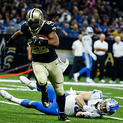 Oct 15, 2017; New Orleans, LA, USA; New Orleans Saints running back Mark Ingram (22) runs past Detroit Lions middle linebacker Nick Bellore (43) for a touchdown during the first half of a game at the Mercedes-Benz Superdome. Mandatory Credit: Derick E. Hingle-USA TODAY Sports