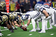 The Dallas Cowboys offensive line gets set at the line of scrimmage opposite the New Orleans Saints defensive line during the NFL week 13 regular season football game against the New Orleans Saints on Thursday, Nov. 29, 2018 in Arlington, Tex. The Cowboys won the game 13-10. (©Paul Anthony Spinelli)