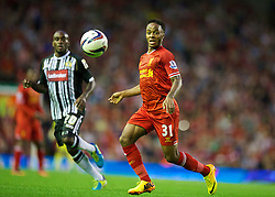 LIVERPOOL, ENGLAND - Tuesday, August 27, 2013: Liverpool's Raheem Sterling in action against Notts County during the Football League Cup 2nd Round match at Anfield. (Pic by David Rawcliffe/Propaganda)