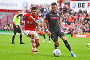 Barnsley midfielder Alex Mowatt (27) and Leeds United midfielder Jack Harrison (22) during the EFL Sky Bet Championship match between Barnsley and Leeds United at Oakwell, Barnsley, England on 15 September 2019.