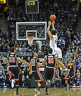 KANSAS CITY, MO - DECEMBER 21:  Guard Nick Russell #12 of the Kansas State Wildcats puts up a shot and scores from mid-court, as the first half ends against the UNLV Runnin' Rebels on December 21, 2010 at the Sprint Center in Kansas City, Missouri.  UNLV defeated Kansas State 63-59.  (Photo by Peter G. Aiken/Getty Images) *** Local Caption *** Nick Russell