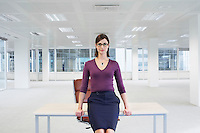 Woman in Empty Office Space