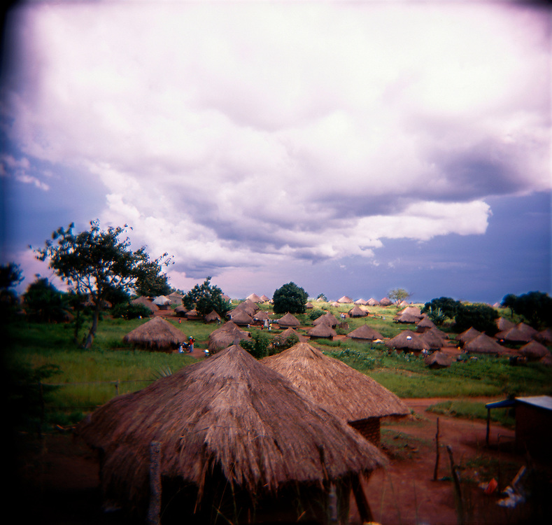 Tradtional thatched huts in the Djinima community. The village is lies near the border of Congo in Central Equatoria province. During the war, nearly all the the residents fled to Congo or nearby Uganda while government forces from Khartoum and the SPLA alternatively controlled the strategic area..Morobo, South Sudan. 08/10/2009..Photo © J.B. Russell