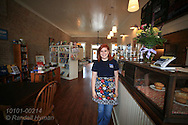 Waitress poses inside Beehive Coffee and Books bookstore in author Harper Lee's hometown of Monroeville, Alabama.