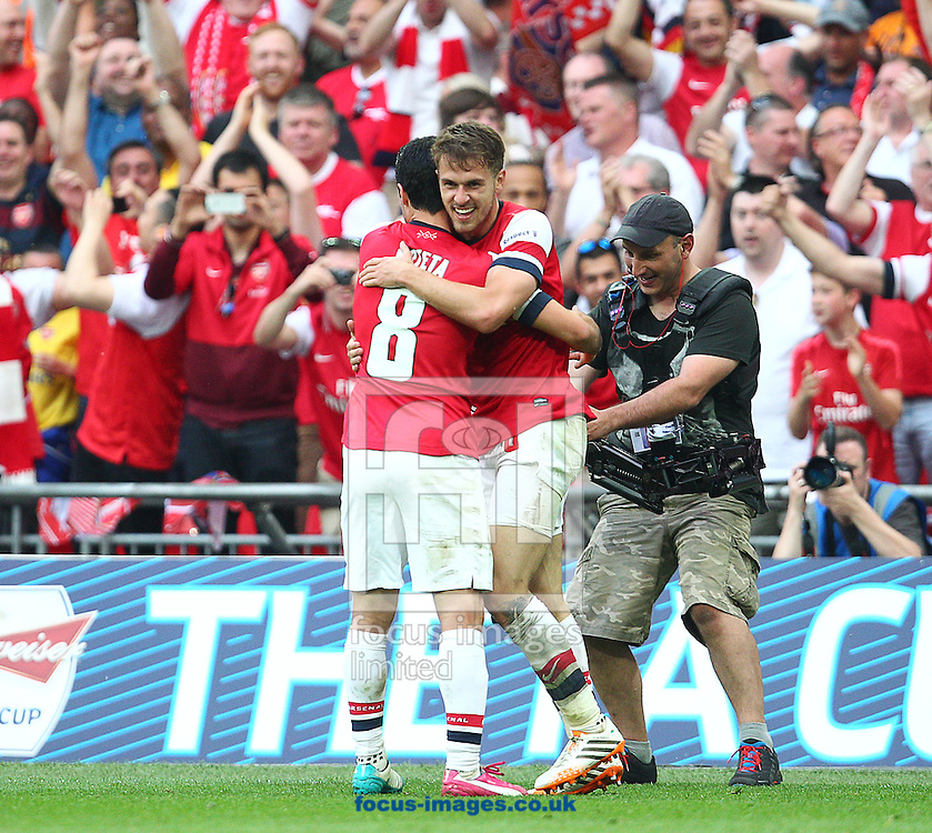 Aaron Ramsey ( R ) of Arsenal celebrates with Mikel Arteta after scoring to make it 3-2 during the The FA Cup Final match at Wembley Stadium, London<br /> Picture by Paul Terry/Focus Images Ltd +44 7545 642257<br /> 17/05/2014