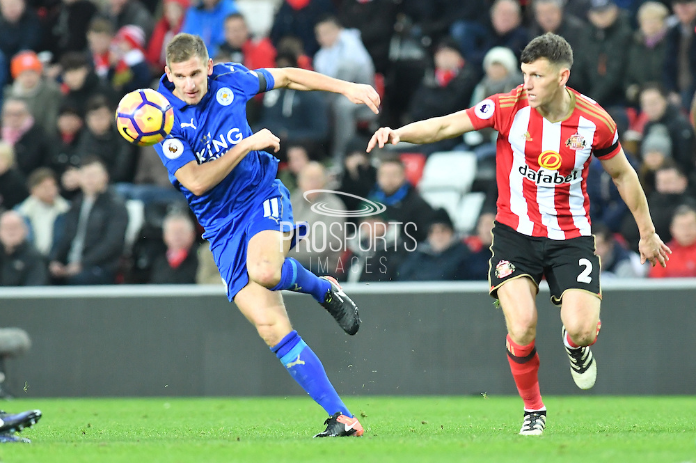 Leicester City's midfielder Marc Albrighton (11) and Billy Jones (2) Sunderland AFC defender  during the Premier League match between Sunderland and Leicester City at the Stadium Of Light, Sunderland, England on 3 December 2016. Photo by Ian Lyall.