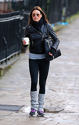 Melanie Sykes without her wedding ring, wearing a black leather bikers jacket, grey top, black leggings and grey leg warmers out and about in London, UK. 18/12/2013<br />BYLINE MUST READ : JAMESY/GOTCHA IMAGES<br /><br />Copyright by © Gotcha Images Ltd. All rights reserved.<br />Usage of this image is conditional upon the acceptance <br />of Gotcha Images Ltd, terms and conditions available at<br />www.gotchaimages.com