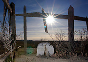 The sun shines as a broken tombstone marks the only remaining grave in an unnamed ghost town along the northern Nevada, Utah border. Colin Braley/Wild West Stock
