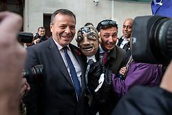 © Licensed to London News Pictures. 04/11/2018. London, UK. Co-founder of the Leave.EU campaign Arron Banks (L) and Andy Wigmore (R) pose with a puppet of Nigel Farage brought by anti-Brexit protesters as they leave BBC Broadcasting House. Photo credit: Rob Pinney/LNP
