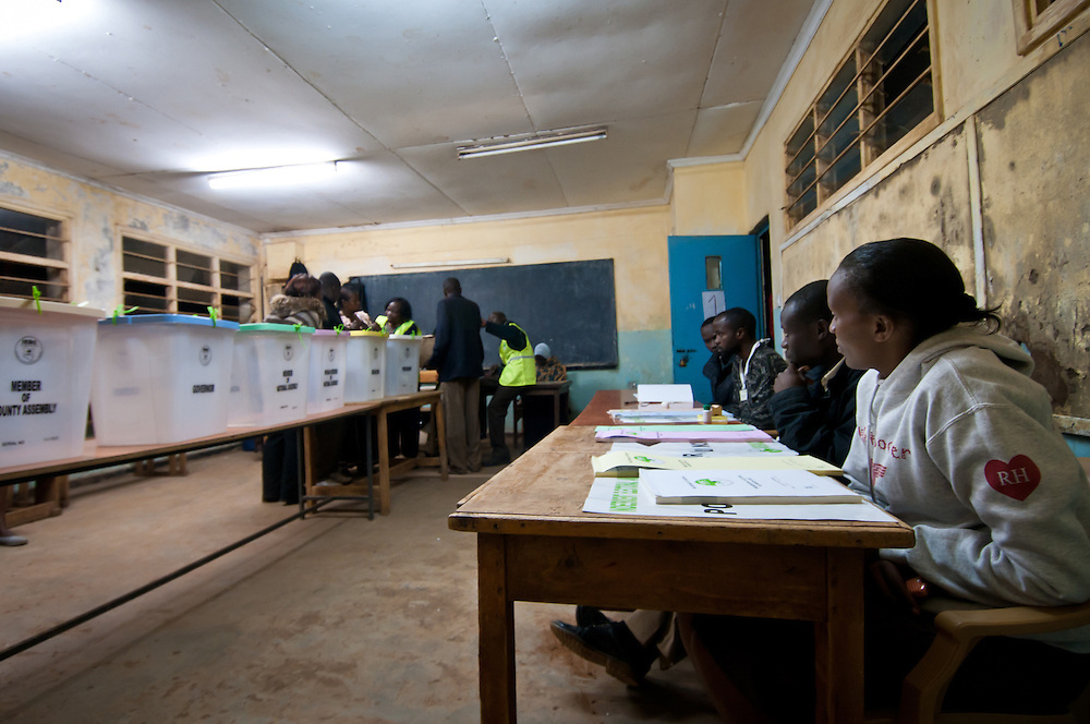 Inside the Olympic Primary School Polling Station in Kibera, IEBC officials were on hand to ensure voters were registered for each ballot- 6 in total- only once. At the polling stations in Kibera, each room had at least five indepent election observers to monitor voting.