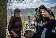 Members of the Abrahamyan family sacrifice a chicken, the blood of which is used to paint a cross on the forehead, to bring good fortune on April 19, 2015 in Karashen, Nagorno-Karabakh. Since signing a ceasefire in a war with Azerbaijan in 1994, Nagorno-Karabakh, officially part of Azerbaijan, has functioned as a self-declared independent republic and de facto part of Armenia, with hostilities along the line of contact between Nagorno-Karabakh and Azerbaijan occasionally flaring up and causing casualties.