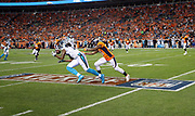 Carolina Panthers wide receiver Kelvin Benjamin (13) reaches for an incomplete second quarter pass as he crosses the 2016 NFL Kickoff logo painted on the field while defended by Denver Broncos cornerback Aqib Talib (21) during the 2016 NFL week 1 regular season football game against the Denver Broncos on Thursday, Sept. 8, 2016 in Denver. The Broncos won the game 21-20. (©Paul Anthony Spinelli)