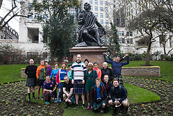 London, UK. 25 January, 2020. Participants in kilts gather around the statue of Robert Burns in Victoria Embankment Gardens before the annual London Kilt Run on Robert Burns Day. The event starts and finishes at the statue and passes a number of Scottish-themed landmarks along the route.