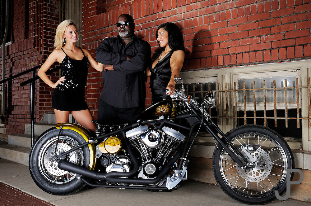 Tommy Bolton, Emily Cochran and Sherise Miller in front of a Brass Ball Bobber motorcycle in Bricktown, Oklahoma City