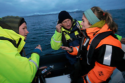 NORWAY ANDENES 8DEC15 - Greenpeace campaigners Christian Bussau (C), Larissa Baeumer of Germany and Erlend Tellnes (L) of Norway during a whale research boat trip off the coast of Andenes, Norway.<br /> <br /> jre/Photo by Jiri Rezac / Greenpeace<br /> <br /> © Jiri Rezac 2015