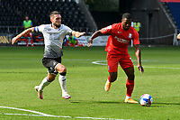 Football - 2020 /2021 EFL Championship - Swansea City vs Birmingham City <br />      <br /> Jeremie Bela of Birmingham on the attack challenged by Matt Grimes of Swansea City<br /> in a match played without fans at the Liberty Stadium<br /> <br /> COLORSPORT/WINSTON BYNORTH