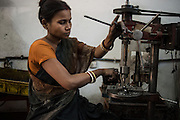 December 22, 2015.Laxmipriya is from Orissa. She works in a tiny factory that makes auto part components in Southern Bangalore. A couple own the factory and they employ only women, as they are far more reliable and hard working than men..