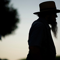 "A silhouetted Amish man awaits his buggy tour in  Lancaster County, PA on August 9, 2014.  A bevy of Amish themed reality television shows (Amish Mafia, Breaking Amish, Return to Amish and Amish Haunting - to be televised soon) have prompted controversy over the negative portrayal.  One woman, a Mary Haverstick, a film maker, has launched a website in support of the Amish (respectamish.org) and has garnered the support of 3,000 businesses.  Her motivation to start the website was to ""end the bigoted programming.""  REUTERS/Mark Makela (UNITED STATES)"