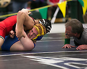 Campbell German of Irondequoit, right, competes against Mike Spallina of Hilton in the championship match for the 170-pound weight class at the state qualifying wrestling meet at the College and Brockport on Saturday, February 14, 2015.