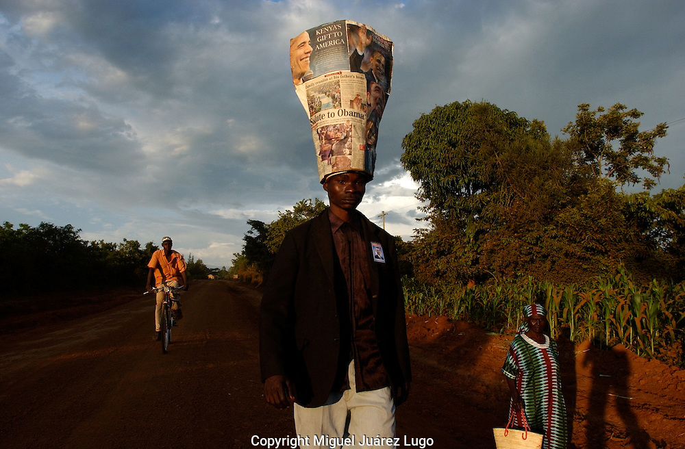 KOGELO, KENYA. A young man, who claims to be a relative of Barack Obama, from the Luo tribe, walks toward Kogelo, the family village, to celebrate the victory of Barack Obama, democratic candidate, that became the 44th US President. (Photo by Miguel Juárez Lugo)