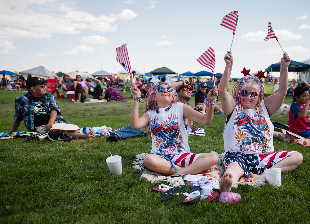 rer070417k/metro/July 04, 2017/Albuquerque Journal<br /> Louise Dye(Cq),left and her mother-in-law Kim Wilson(Cq) rock out to music on the lawn at Balloon Fiesta Park Tuesday afternoon. They waited patiently in the baking sun for Country music superstar Clint Black who was the main event at this year's event. <br /> Albuquerque, New Mexico Roberto E. Rosales/Albuquerque Journal