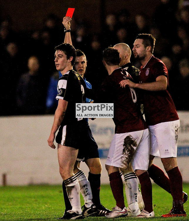 Wick's Michael Steven is shown a striaght red card by referee Nick Walsh in tonights Scottish Cup tie at Prestonfield Linlithgow