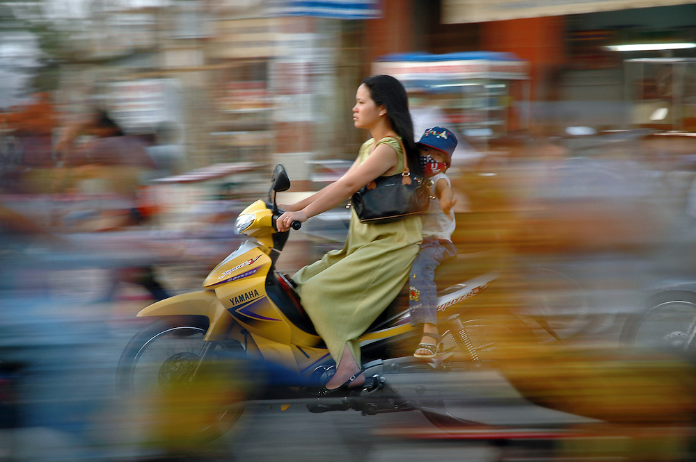 Woman and child in traffic. Vung Tao, Vietnam