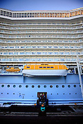A forklift arrives with new supplies for the cruise ship Oasis of the Seas. The ship, currently the largest in the world, is owned by Royal Carribean Cruise Line.