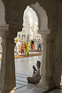 The golden temple is the Sikh religion's most holy place of peace and spiritual awakening.  Amritsar, India.