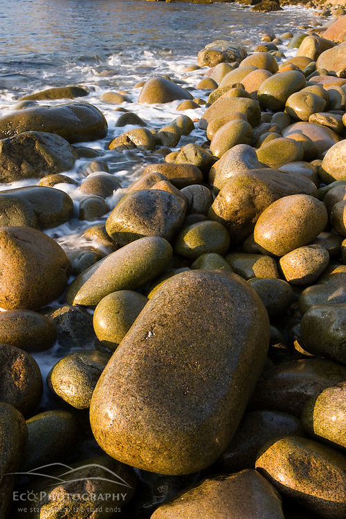 Closeup of water on the cobblestones in Monument Cove in Maine USA