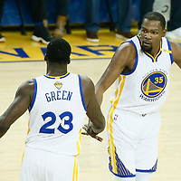 04 June 2017: Golden State Warriors forward Kevin Durant (35) celebrates with Golden State Warriors forward Draymond Green (23) during the Golden State Warriors 132-113 victory over the Cleveland Cavaliers, in game 2 of the 2017 NBA Finals, at the Oracle Arena, Oakland, California, USA.