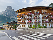 Posta Zirm Hotel, Corvara, Dolomites, Italy. Corvara is a prestigious tourist center in Alta Badia, at the top of Val/Valle/Valley of Badia in the province of Südtirol/South Tyrol/Alto Adige, Italy. Corvara is surrounded by the peaks of the Dolomites (or Dolomiti), a part of the Southern Limestone Alps in Europe. The Dolomites were declared a natural World Heritage Site (2009) by UNESCO.