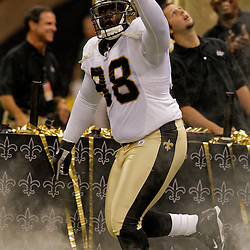 2009 August 14: New Orleans Saints defensive tackle Sedrick Ellis (98) during introductions before a preseason opener between the Cincinnati Bengals and the New Orleans Saints at the Louisiana Superdome in New Orleans, Louisiana.